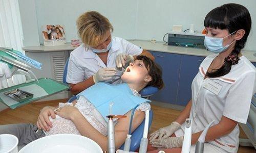 Процесс лечения зубов беременной женщине