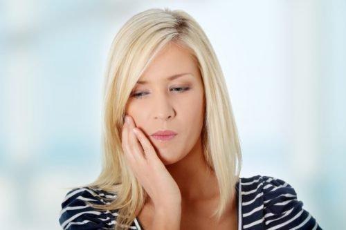 Болит десна у зуба мудрости - причины